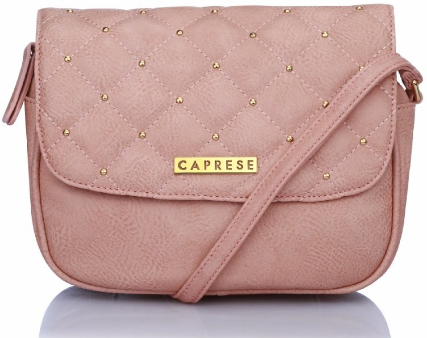 Caprese Women Pink Leatherette Sling Bag Almond - Price in India ...