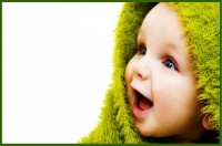 Cute Baby In Green Towel Poster Paper Print(12 inch X 18 inch, Rolled)