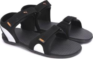 2a792c1250cf Puma Men Puma Black Puma Silver Vibrant Orange Sports Sandals Best Price in  India