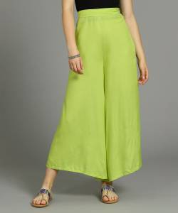 W Flared Women Green Trousers