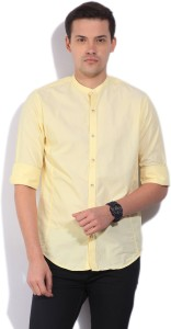 389d49f0454a Peter England Men s Solid Casual Yellow Shirt Best Price in India ...