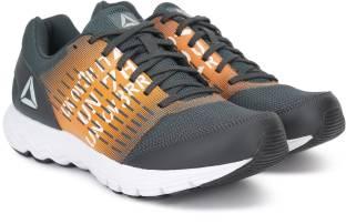 3372c1e9f7c406 REEBOK PUMP PLUS TECH Running Shoes For Men - Buy LEAD ORANGE WHITE ...