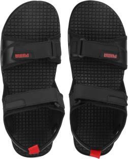 5dd6b88f3cb32 Puma Men black-brilliant blue Sports Sandals - Buy black-brilliant ...