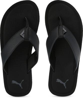 black puma flip flops