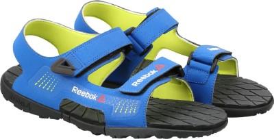 24721418d 50% OFF on REEBOK Men BLUE YELLOW BLK GRAVEL Sports Sandals on Flipkart