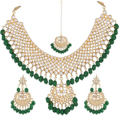 Aradhya Brass Jewel Set(Gold, Green) at flipkart