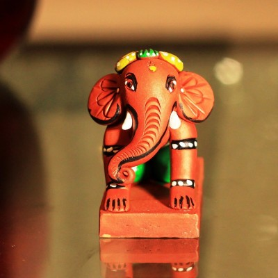 Unravel India Lord Ganesha Showpiece  -  9 cm(Terracotta, Multicolor)  available at flipkart for Rs.549