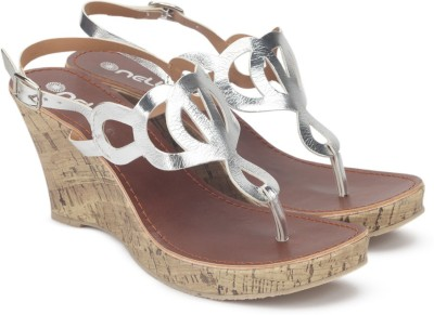 Nell Women SILVER Wedges at flipkart