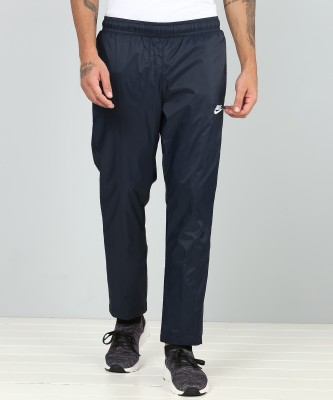 Nike Solid Men Blue Track Pants at flipkart