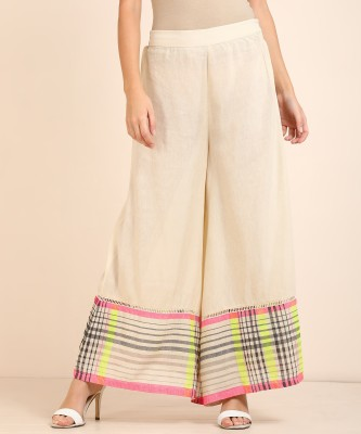 W Relaxed Women Beige Trousers at flipkart