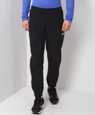 REEBOK Solid Men Black Track Pants at flipkart