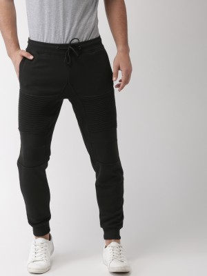Mast & Harbour Solid Men Black Track Pants at flipkart