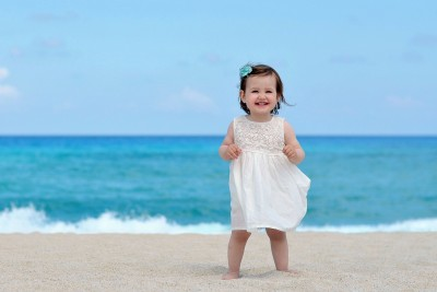 Child's Love - Smiling Girl on the Sea Shore Paper Print(12 inch X 18 inch, Stretched)