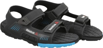 Reebok Men COAL/BLUE/GRAVEL/BLACK Sports Sandals at flipkart