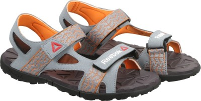 Reebok Men AST DUST/NACHO/GRY/BLK Sports Sandals at flipkart