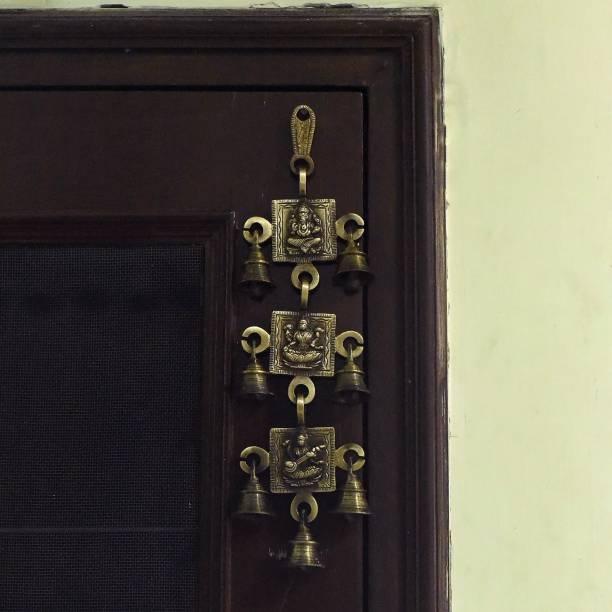 eCraftIndia Brass Ganesha Laxmi Saraswati Wall Hanging Bells Decorative Showpiece  -  31 cm