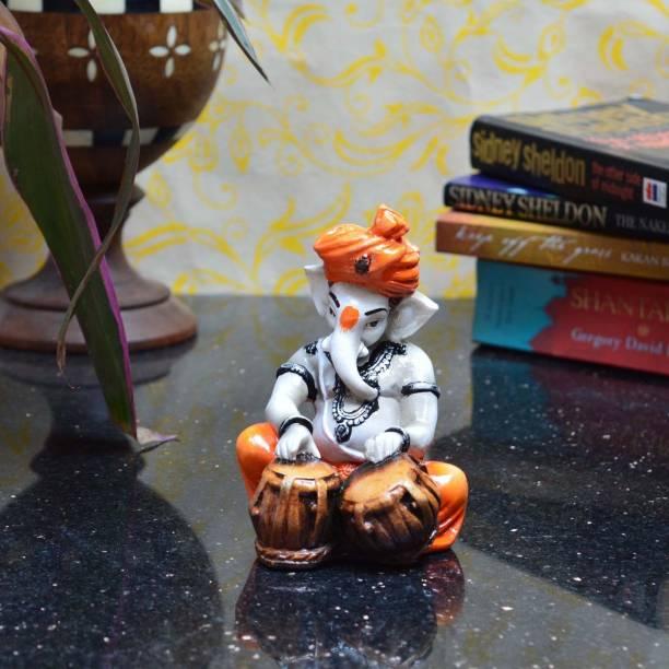 eCraftIndia Lord Ganesha Playing Tabla Decorative Showpiece  -  12.7 cm