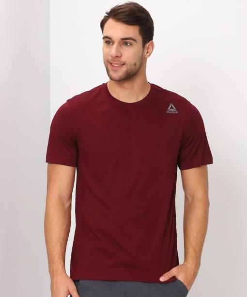 REEBOK Solid Men Round Neck Maroon T-Shirt