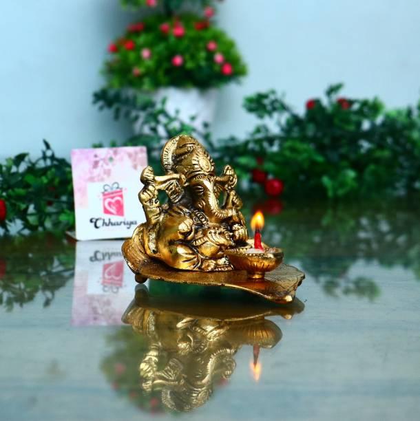 Chhariya Crafts Lord Ganesh Sitting on Leaf With Diya Decorative Showpiece  -  8 cm