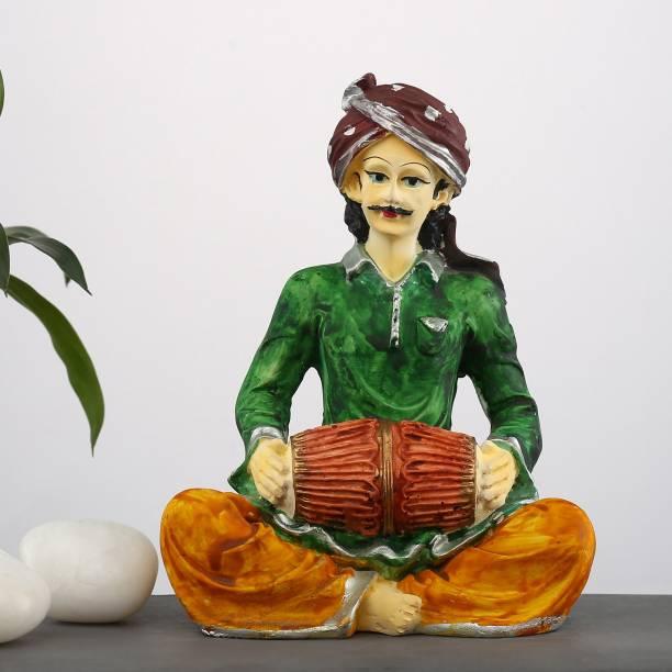 Flipkart SmartBuy Rajasthani Men Playing Dholak|Rajasthani Idol |Artist Idols||table decorations items| decorative items for room in Racks & Shelves |Musicians Idols| home decor Showpieces |handicraft items |Statues |Showpieces gift sets |Rajasthani Statue for home Decorative Showpiece  -  16 cm