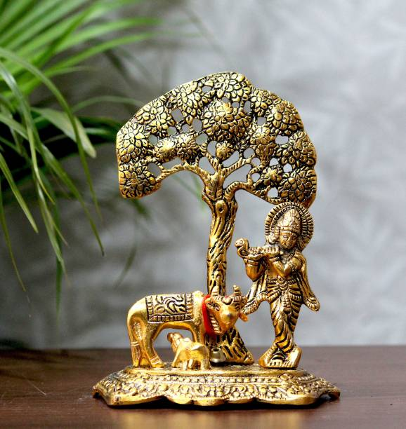 Craft Junction Handcrafted Lord Krishna Playing Basuri with Cow n Calf Under Tree Decorative Showpiece  -  17 cm
