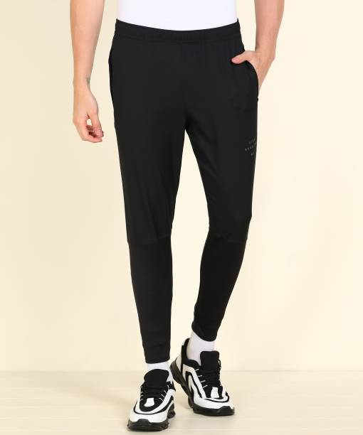 NIKE Solid Men Black Track Pants