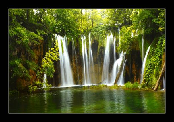 Asiwal Beautiful Waterfall In Forest Painting with Synthetic Frame� Digital Reprint 14 inch x 20 inch Painting