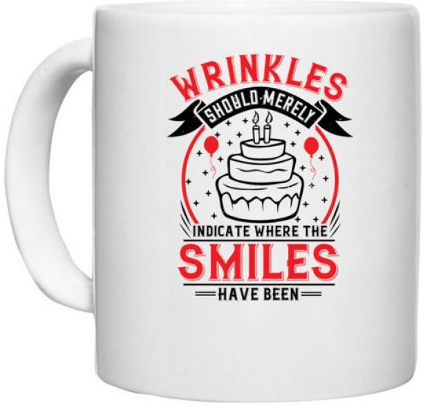 UDNAG White Ceramic Coffee / Tea 'Birthday   Wrinkles should merely indicate where the smiles have been' Perfect for Gifting [330ml] Ceramic Coffee Mug