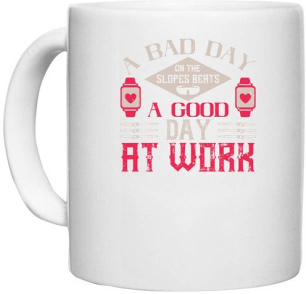 UDNAG White Ceramic Coffee / Tea 'Skiing   A bad day on the slopes beats a good day at work' Perfect for Gifting [330ml] Ceramic Coffee Mug