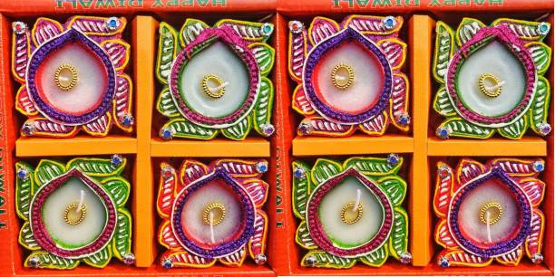 KanthiMala Swastik Decorative Diya with wax- Pack of 8- Handmade- For Decoration and Gifting Candle
