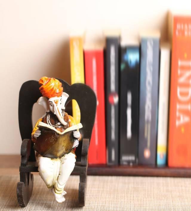 eCraftIndia Lord Ganesha Reading Book on Chair Showpiece  -  16.51 cm