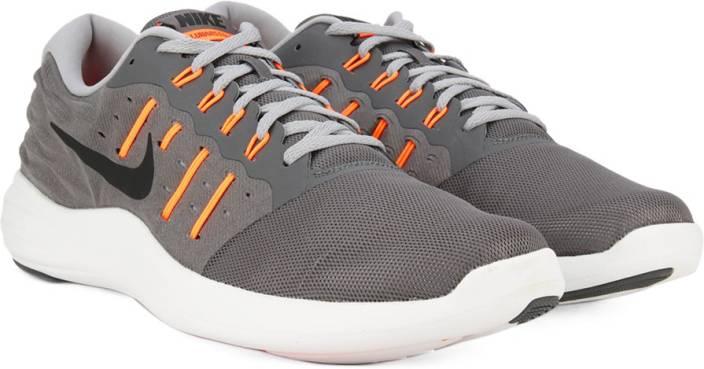 new product f5c62 bd5e2 Nike LUNARSTELOS Running Shoes For Men (Grey, Orange, Black)