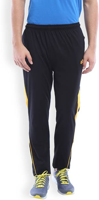 2go Solid Men Black Yellow Track Pants Buy Black Goldfusion 2go