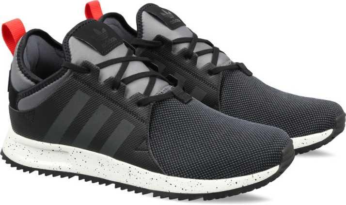 on sale f0587 e4e9c ADIDAS ORIGINALS X PLR SNKRBOOT Sneakers For Men (Black)