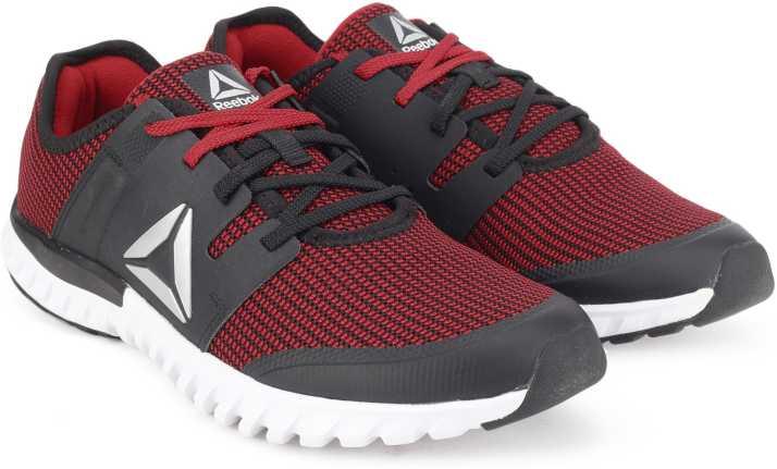db475304c13d REEBOK TWIST RUN Running Shoes For Men - Buy RED GRAVEL METSIL WHT ...