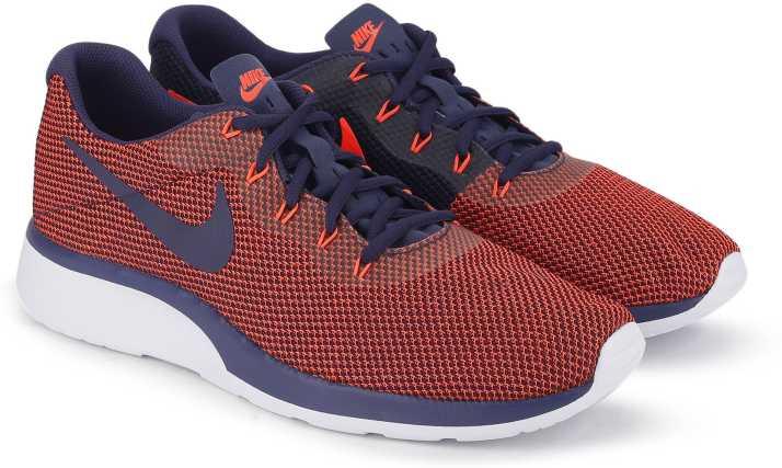 brand new 84182 d7af7 Nike NIKE TANJUN RACER Running Shoes For Men (Red, Blue)