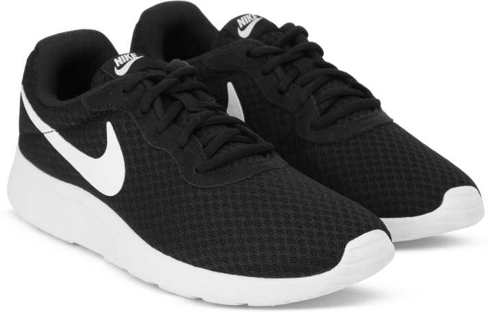low priced 86933 9da3a Nike TANJUN SS 19 Running Shoes For Men (Black, White)