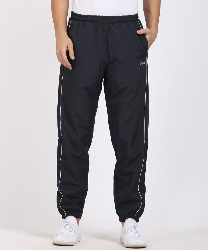 Fila Solid Men Blue Track Pants - Buy