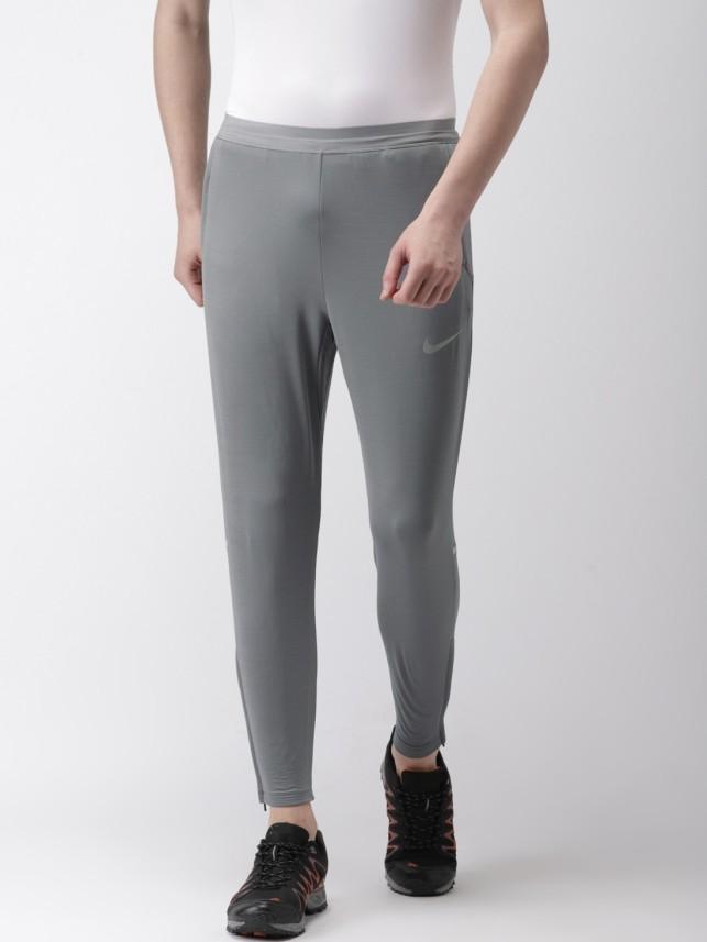 Nike Solid Men Grey Track Pants - Buy