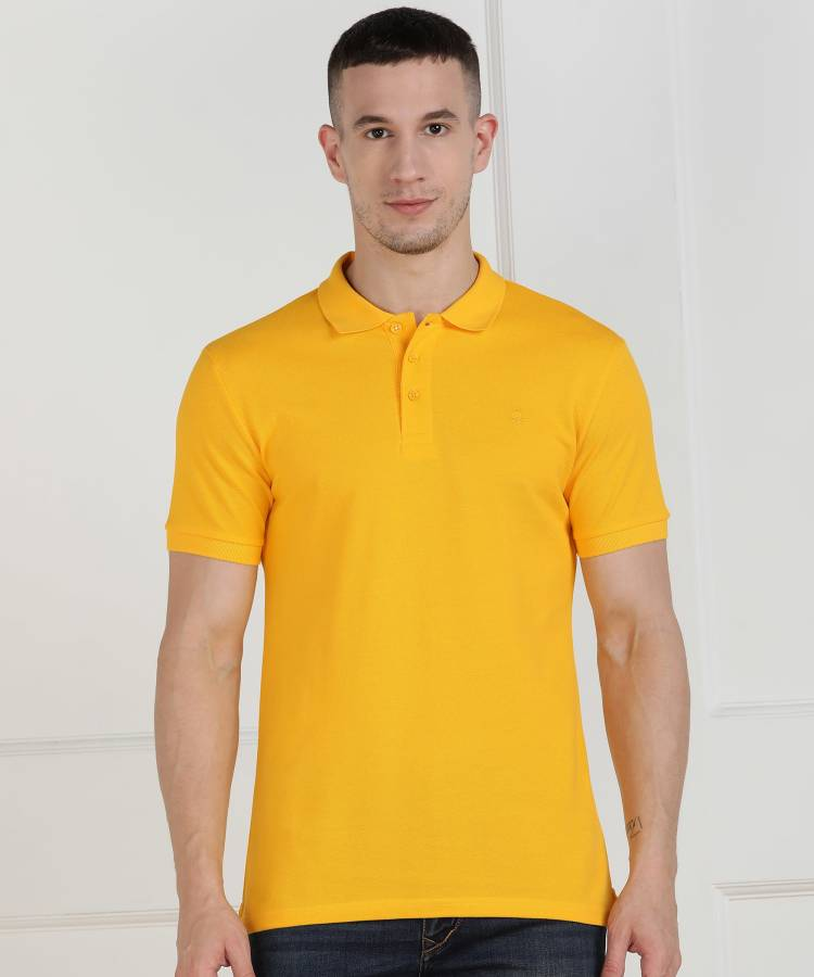 Solid Men Polo Neck Yellow T-Shirt Price in India