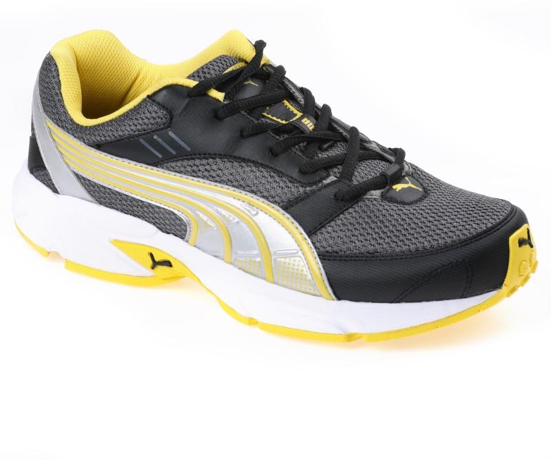 Puma Pluto DP Cricket Shoes For Men(Yellow, Black)