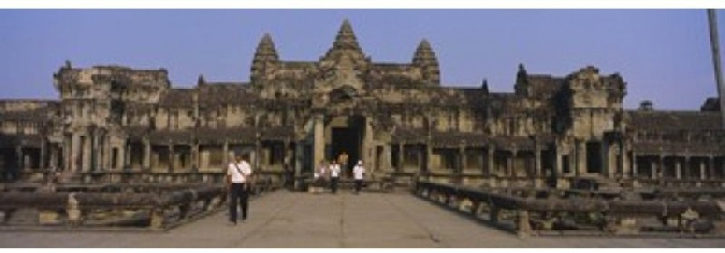 Tourists walking in front of an old temple Angkor Wat Siem Reap Cambodia Canvas Art - Panoramic Images (18 x 6) Canvas Art(20 inch X 30 inch)