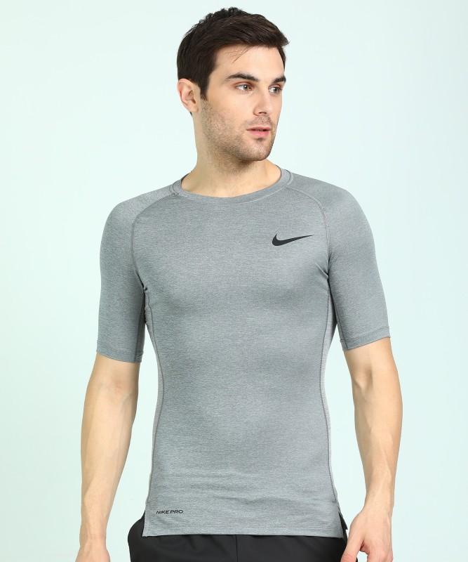 Nike Solid Men Round Neck Grey T-Shirt