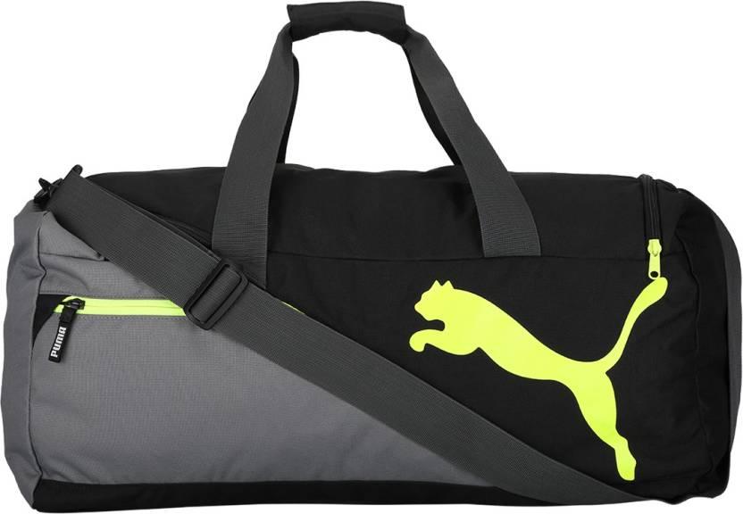 Puma Fundamentals Sports Bag M Gym Bag QUIET SHADE-Safety Yellow ... afbcfcee848d3