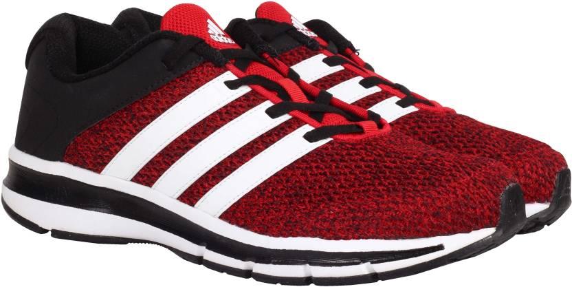 adidas magnus m per gli uomini comprano scarpe da corsa scarle / ftwwht / cblack