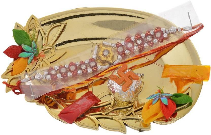 Handicraft Kottage Religious Rakhi Rakhi  (1 Pooja Plate, 1 Roli Pouch, 1 Chawal Pouch, 1 Coconut, 1 Rakhi)- 64% off