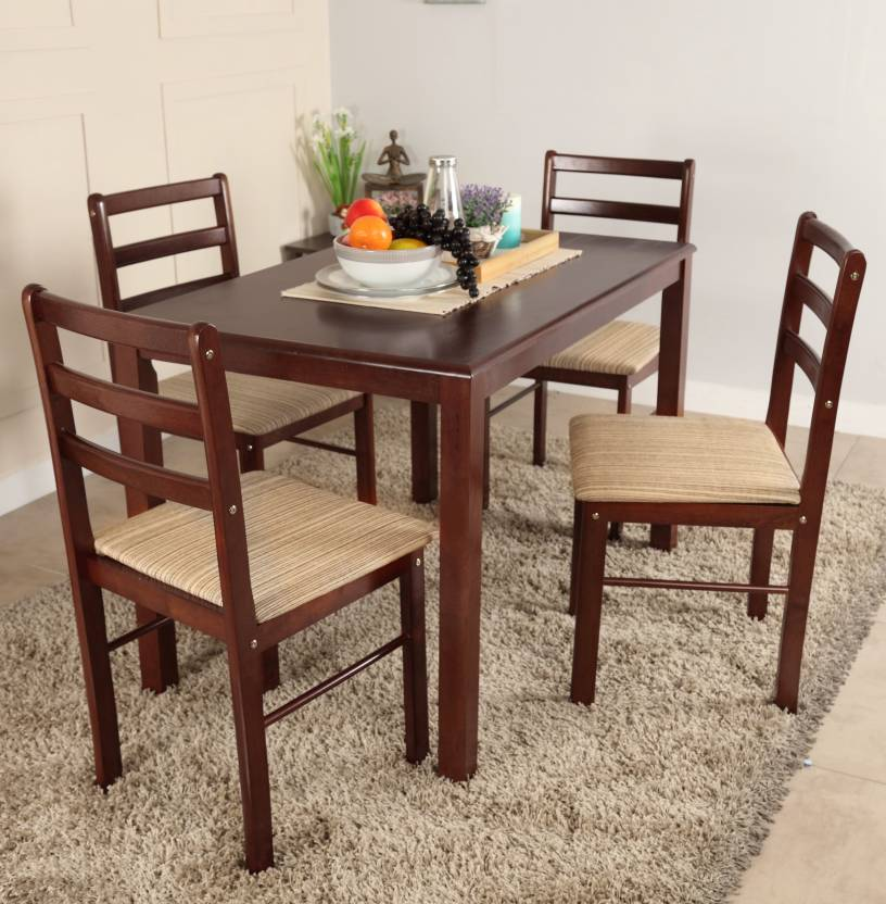 Woodness solid wood 4 seater dining set price in india for Dining table set designs
