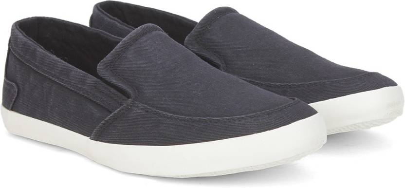 Flipkart  Offer Get upto 50% off on Men's Footwears United Colors of Benetton Slip on For Men  (Black)