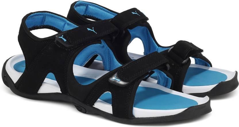 91c58ba97fe5 Puma Men black-atomic blue Sandals - Buy black-atomic blue Color ...