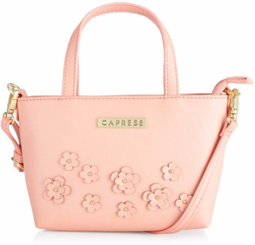 Caprese Women Casual Pink Leatherette Sling Bag Soft Pink - Price in India   5c1e6f76b0ac3